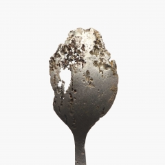 Corroded teaspoon